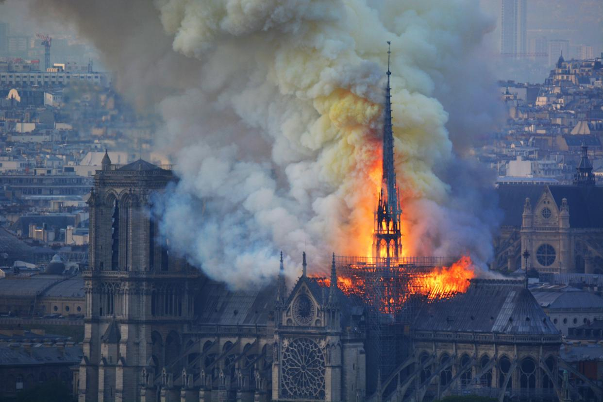 Smoke and flames rise during a fire at the landmark Notre-Dame Cathedral in central Paris on April 15, 2019, potentially involving renovation works being carried out at the site, the fire service said. (Photo: Hubert Hitier/AFP/Getty Images)