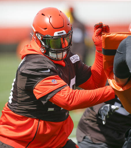 Cleveland Browns' Sheldon Richardson runs through a drill during an NFL football organized team activity session at the team's training facility Wednesday, May 15, 2019, in Berea, Ohio. (AP Photo/Ron Schwane)