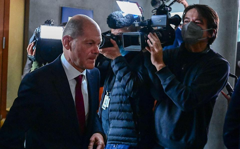 German Finance Minister, Vice-Chancellor, and the Social Democratic Party's (SPD) chancellor candidate Olaf Scholz leaves after he was questioned during a parliamentary finance inquiry over an investigation into an anti-money laundering agency overseen by his ministry, on September 20, 2021 at the Bundestag compound in Berlin. - Scholz's appearance before the German parliament's finance committee comes less than a week before Germans go to the polls in national elections on September 26. (Photo by Tobias Schwarz / AFP) (Photo by TOBIAS SCHWARZ/AFP via Getty Images) - TOBIAS SCHWARZ/AFP
