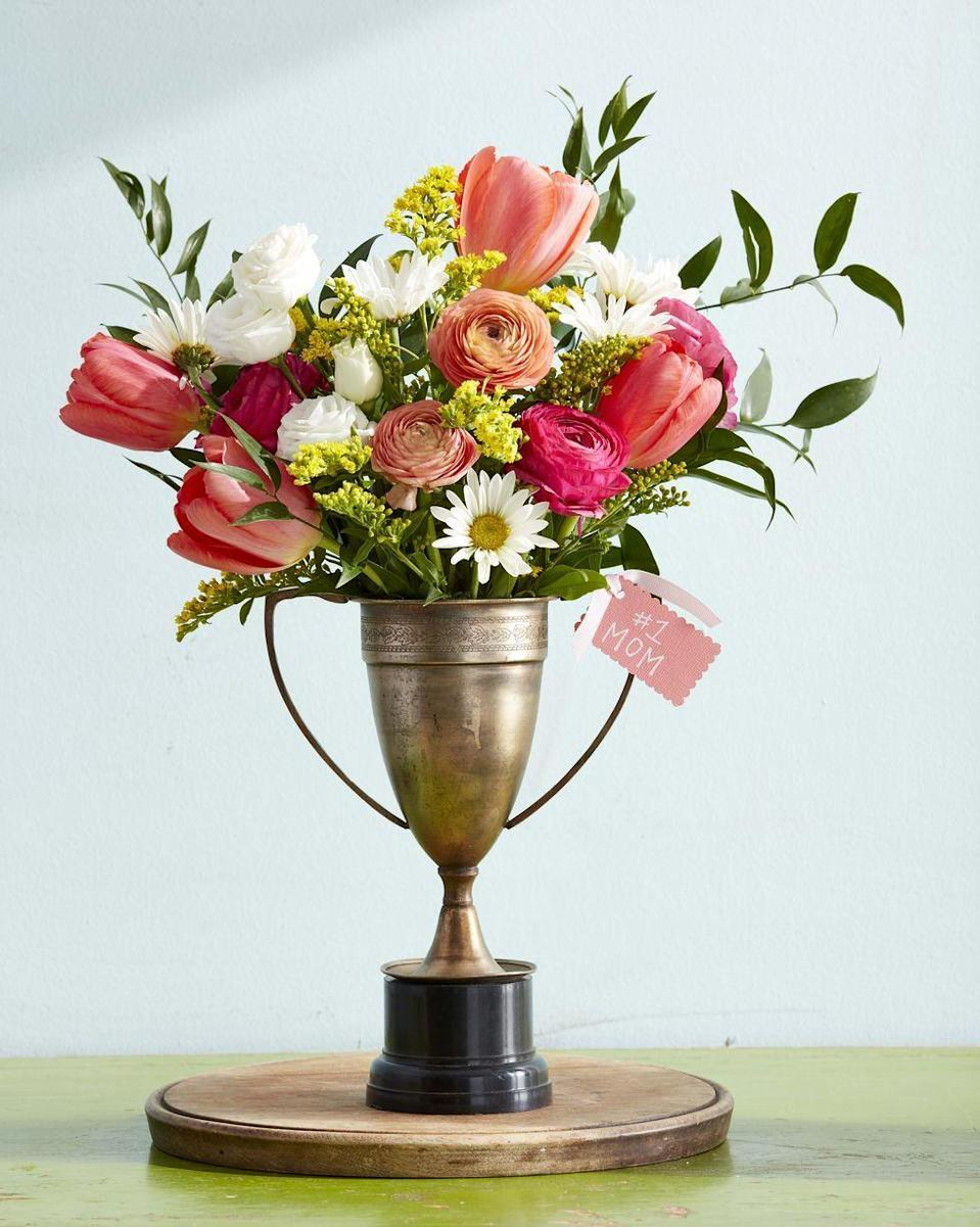 """<p>Your mom's a real winner — and this beautiful bouquet will serve as the perfect reminder. Track down a vintage prize trophy (or <a href=""""https://www.amazon.com/Decade-Awards-Gold-Silver-Corporate-Trophies/dp/B011LX2P7K/?tag=syn-yahoo-20&ascsubtag=%5Bartid%7C10055.g.2412%5Bsrc%7Cyahoo-us"""" rel=""""nofollow noopener"""" target=""""_blank"""" data-ylk=""""slk:pick up a plastic one on Amazon"""" class=""""link rapid-noclick-resp"""">pick up a plastic one on Amazon</a>) and then fill it with garden-fresh blooms. </p><p><em><a href=""""https://www.countryliving.com/diy-crafts/how-to/g771/mothers-day-crafts-0509/"""" rel=""""nofollow noopener"""" target=""""_blank"""" data-ylk=""""slk:Get the tutorial at Country Living »"""" class=""""link rapid-noclick-resp"""">Get the tutorial at Country Living » </a></em></p>"""