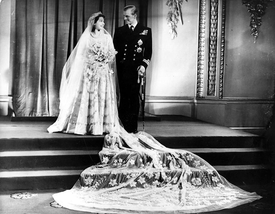 The Queen, then Princess Elizabeth, married Prince Philip in a custom design by Norman Hartnell in November 1947. (Getty Images)