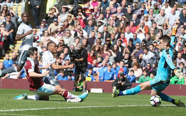 <span>Anthony Martial slides the ball past Tom Heaton in the Burnley goal to open the scoring at Turf Moor</span> <span>Credit: Getty Images </span>