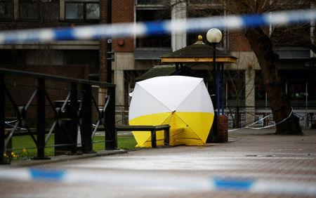 A tent covers the park bench where former Russian intelligence agent Sergei Skripal and his daughter Yulia were found after they were poisoned, in Salisbury, Britain March 12, 2018. REUTERS/Henry Nicholls