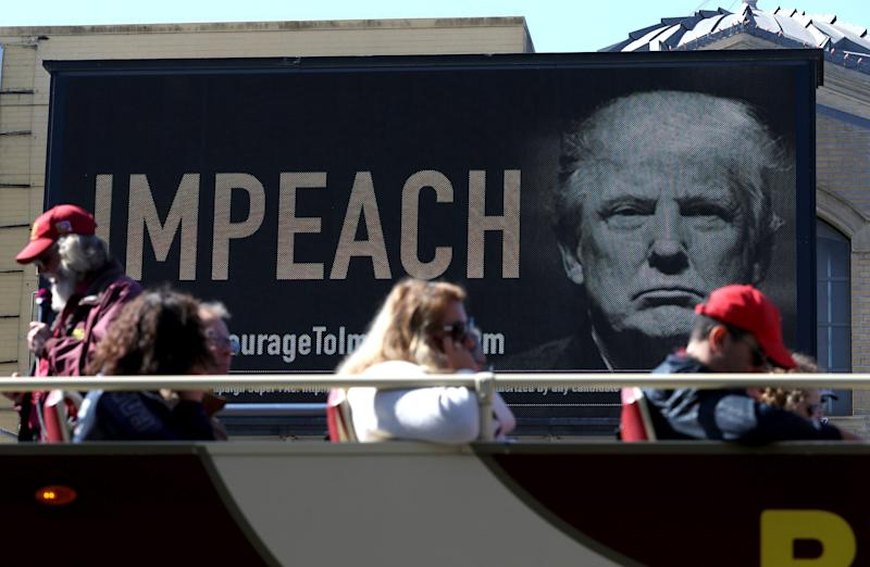 An electronic billboard in San Francisco calls for the impeachment of President Donald Trump.