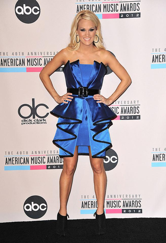 LOS ANGELES, CA - NOVEMBER 18:  Singer Carrie Underwood poses in the press room at the 40th American Music Awards at Nokia Theatre L.A. Live on November 18, 2012 in Los Angeles, California.  (Photo by Jason LaVeris/FilmMagic)