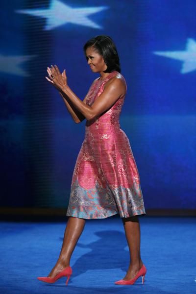 First lady Michelle Obama exits the stage after speaking during day one of the Democratic National Convention at Time Warner Cable Arena on September 4, 2012 in Charlotte, North Carolina. The DNC that will run through September 7, will nominate U.S. President Barack Obama as the Democratic presidential candidate. (Photo by Alex Wong/Getty Images)