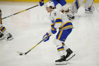Buffalo Sabres forward Jack Eichel (9) skates during warm ups prior to the first period of an NHL hockey game against the New Jersey Devils, Thursday, Feb. 25, 2021, in Buffalo, N.Y. (AP Photo/Jeffrey T. Barnes)