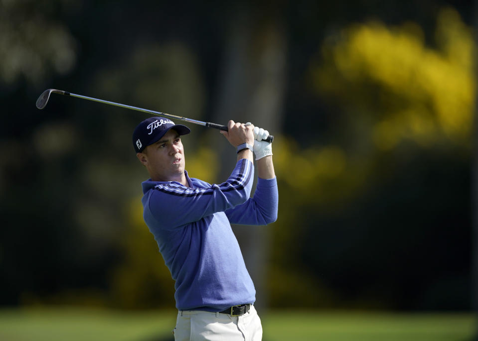 Justin Thomas watches his approach shot on the 13th hole during the Genesis Invitational pro-am golf event at Riviera Country Club, Wednesday, Feb. 12, 2020, in the Pacific Palisades area of Los Angeles. (AP Photo/Ryan Kang)