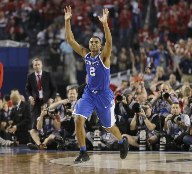 Kentucky guard Aaron Harrison (2) celebrates after making a three-point basket in the final seconds against Wisconsin to win the game 74-73 during their NCAA Final Four tournament college basketball semifinal game Saturday, April 5, 2014, in Arlington, Texas. (AP Photo/Charlie Neibergall)