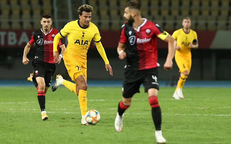 Tottenham's Dele Alli, second left, runs with the ball during a Europa League third qualifying round soccer match between Shkendija and Tottenham  - AP