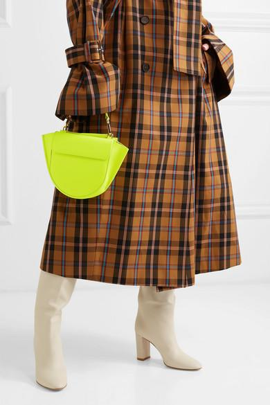 <p>This Hortensia neon-green mini bag calls out attention to its bright hue. Made from leather in Italy, the half-moon bag also comes with back pockets to slot in your cards and phone. Perfect! </p>