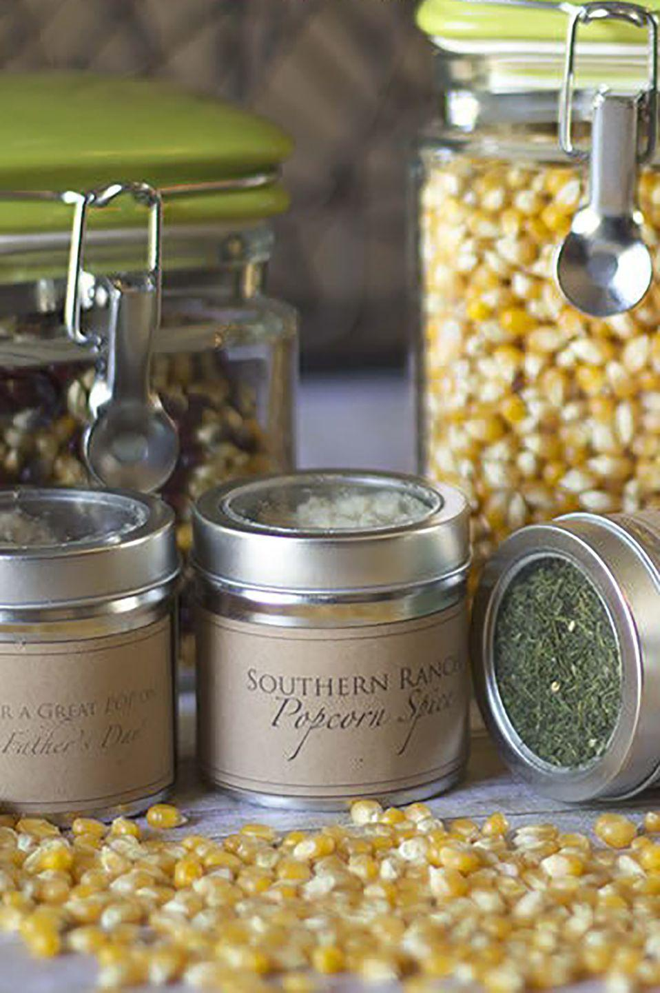 """<p>This creative gift is perfect for dads who like to enjoy popcorn every time they watch a movie. You can whip up different seasonings with just four or five ingredients each!</p><p><strong>Get the tutorial at <a href=""""https://diyprojects.com/fathers-day-gift-ideas/"""" rel=""""nofollow noopener"""" target=""""_blank"""" data-ylk=""""slk:DIY Projects"""" class=""""link rapid-noclick-resp"""">DIY Projects</a>. </strong></p><p><strong><a class=""""link rapid-noclick-resp"""" href=""""https://www.amazon.com/dp/B01FY69CPS/ref=sspa_dk_detail_0?psc=1&pd_rd_i=B01FY69CPS&pd_rd_w=MTL33&pf_rd_p=48d372c1-f7e1-4b8b-9d02-4bd86f5158c5&pd_rd_wg=8opck&pf_rd_r=77WF4WFQ06A7ZFEBVTXH&pd_rd_r=f2b36a70-6046-476c-b1a8-cc6aca805025&spLa=ZW5jcnlwdGVkUXVhbGlmaWVyPUEyMVE3WTk0RDZJMThSJmVuY3J5cHRlZElkPUEwMTY3OTE0MVVYTTlDT1FQSjVTJmVuY3J5cHRlZEFkSWQ9QTAyMTk4NDAxQjBMWlpPNEdVUVRQJndpZGdldE5hbWU9c3BfZGV0YWlsJmFjdGlvbj1jbGlja1JlZGlyZWN0JmRvTm90TG9nQ2xpY2s9dHJ1ZQ%3D%3D&tag=syn-yahoo-20&ascsubtag=%5Bartid%7C10050.g.1171%5Bsrc%7Cyahoo-us"""" rel=""""nofollow noopener"""" target=""""_blank"""" data-ylk=""""slk:SHOP SPICE TINS"""">SHOP SPICE TINS</a></strong></p>"""