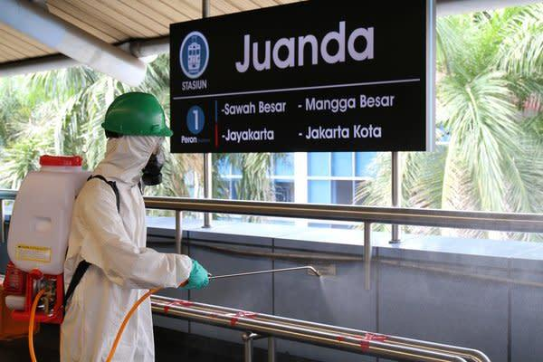 Worker Sprays Disinfection Liquid on Stations and Trains Daily.