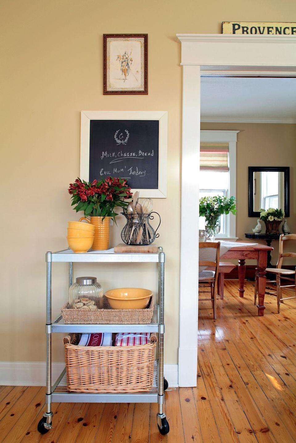 <p>All out of kitchen storage? Make use of your bar cart's shelving to store kitchen towels, bowls, utensils, and more. </p>