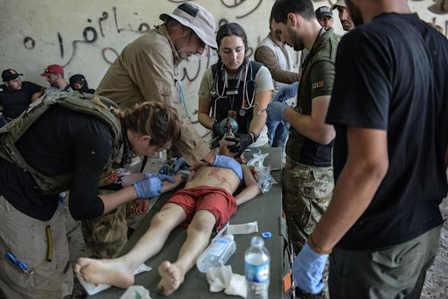 <p>An Iraqi boy, who suffered injuries following a suicide attack as he was escaping the Old City of Mosul, receives treatment at a field hospital on June 23, 2017. (Photo: Mohamed el-Shahed/AFP/Getty Images) </p>