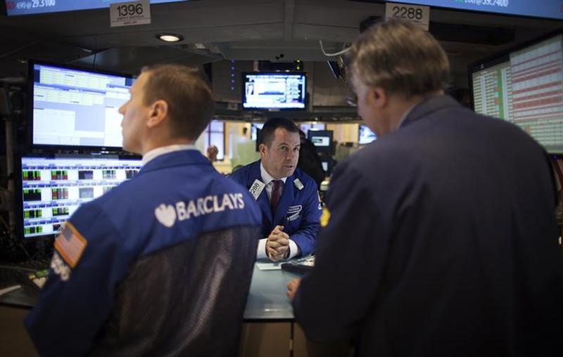 Traders work on the floor of the New York Stock Exchange during the opening bell in New York, November 27, 2013. REUTERS/Carlo Allegri