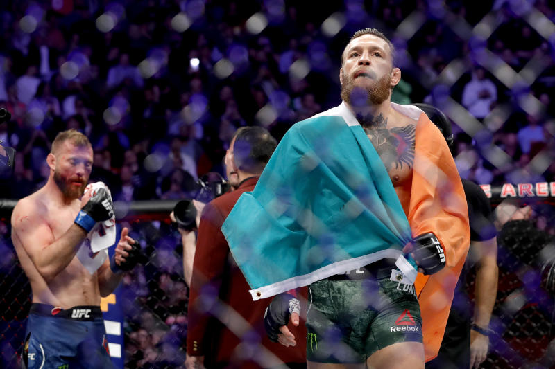 LAS VEGAS, NEVADA - JANUARY 18: (R) Conor McGregor celebrates his first round TKO victory against Donald Cerrone in a welterweight bout during UFC246 at T-Mobile Arena on January 18, 2020 in Las Vegas, Nevada. (Photo by Steve Marcus/Getty Images)