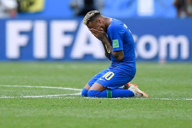 Emotional moment: Neymar cried after scoring late in Brazil's 2-0 win over Costa Rica (AFP Photo/GABRIEL BOUYS )