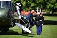 President Trump, accompanied by First Lady Melania, who has already managed an outfit change hours after landing in the UK, step off Marine Force One in the grounds of Buckingham Palace. (Jeff J Mitchell/Getty Images)