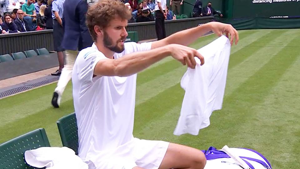 Oscar Otte, pictured here struggling with the shorts he was wearing at Wimbledon.