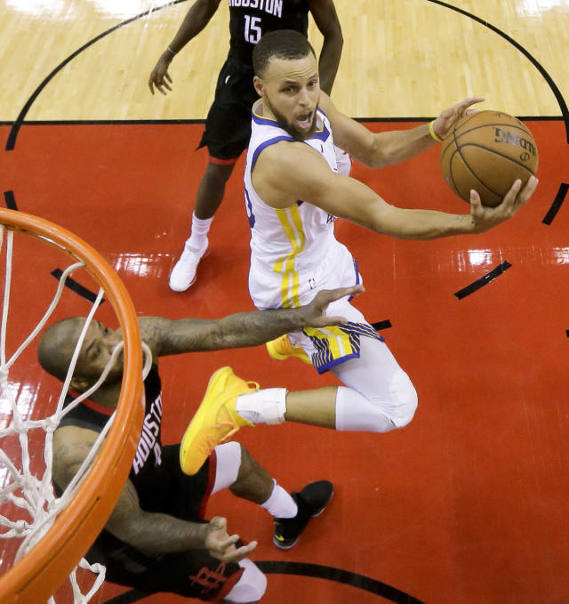 Golden State Warriors guard Stephen Curry shoots past Houston Rockets forward PJ Tucker during the second half in Game 5 of the NBA basketball playoffs Western Conference finals in Houston, Thursday, May 24, 2018. (AP Photo/David J. Phillip)