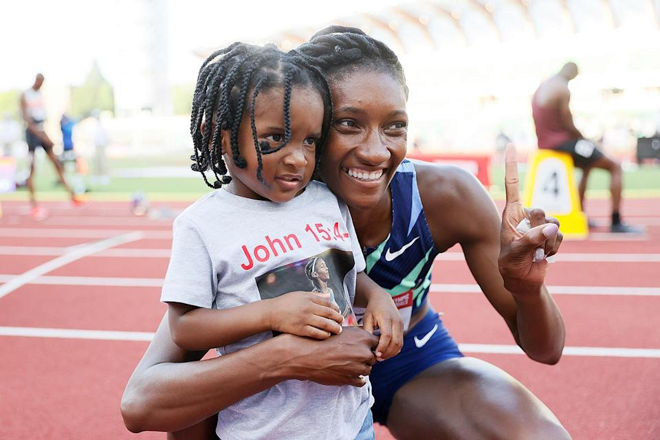 """<p>Hayes came in first place in the women's 400m at the track & field trials, securing her first Olympic appearance in Tokyo. There to celebrate the milestone achievement was her son Demetrius, whom she welcomed in October 2018. </p> <p>""""Coming back, it was tough,"""" the athlete told <a href=""""https://onherturf.nbcsports.com/2021/06/22/tokyo-olympics-meet-the-moms-who-have-qualified-for-the-u-s-team/"""" rel=""""nofollow noopener"""" target=""""_blank"""" data-ylk=""""slk:NBC Sports"""" class=""""link rapid-noclick-resp"""">NBC Sports</a> of returning to track after giving birth. """"It was like I had to learn how to run all over again. I couldn't come out of [the blocks], my stride was different.""""</p>"""