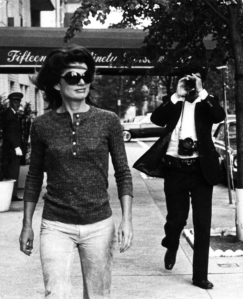 <p>Jackie Kennedy Onassis is photographed by Ron Galella as she walks in her Upper East Side neighborhood in New York. </p>