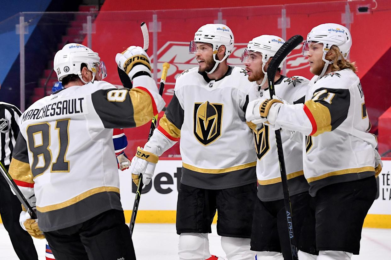 MONTREAL, QUEBEC - JUNE 24: Reilly Smith #19 of the Vegas Golden Knights celebrates with his teammates after scoring a goal against Carey Price #31 of the Montreal Canadiens during the first period in Game Six of the Stanley Cup Semifinals of the 2021 Stanley Cup Playoffs at Bell Centre on June 24, 2021 in Montreal, Quebec. (Photo by Minas Panagiotakis/Getty Images)