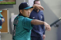 Seattle Mariners starting pitcher Yusei Kikuchi stays loose by going through pitching motions in the dugout between the fourth and fifth innings of the team's baseball game against the Tampa Bay Rays, Friday, June 18, 2021, in Seattle. (AP Photo/Ted S. Warren)