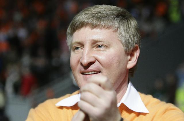 FILE - In this Wednesday, May 5, 2010 file photo, Shakhtar Donetsk's billionaire owner Rinat Akhmetov celebrates after winning the Ukrainian Premier League soccer match against Dynamo Kiev at Donbass-Arena stadium in Donetsk, Ukraine. Six South Americans - five Brazilians and one Argentine - have refused to return to Ukraine to play for their football club in Donetsk as conflict rages around the city, risking possible fines and suspensions for breach of contract. (AP Photo/Andrey Lukatsky)