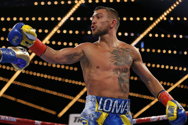 Vasiliy Lomachenko will go a full year without an official bout. (AP Photo/Adam Hunger)