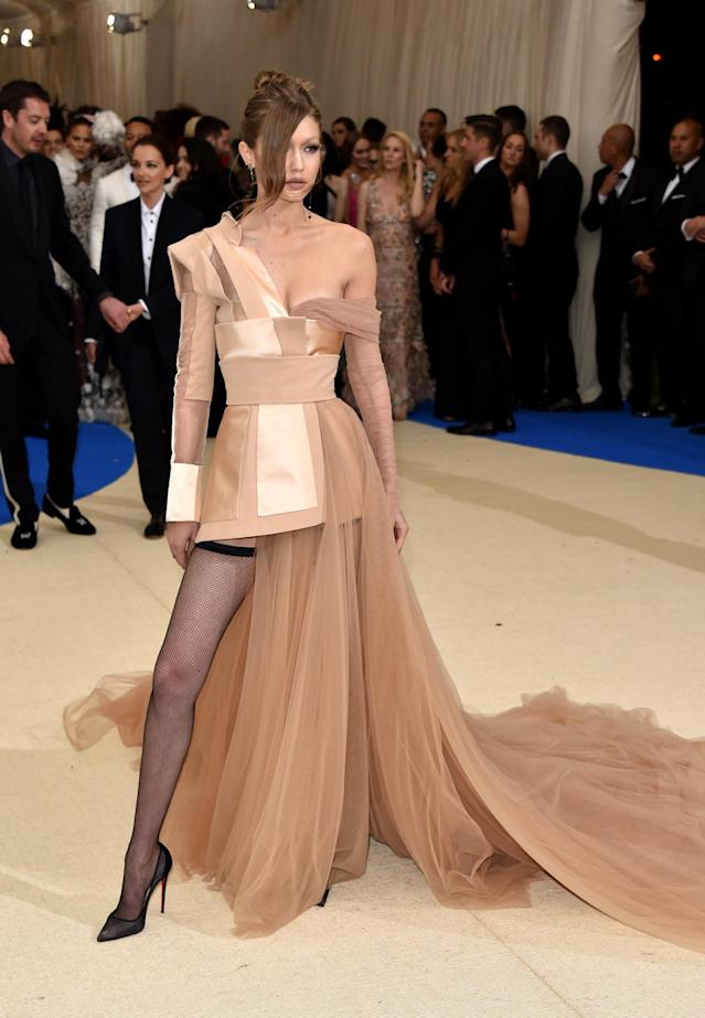 <p>Hadid wore her own Tommy Hilfiger x Gigi creation to the event that she paired with panty hose. She accessorized with custom Jacquie Aiche jewelry. (Photo by John Shearer/Getty Images) </p>