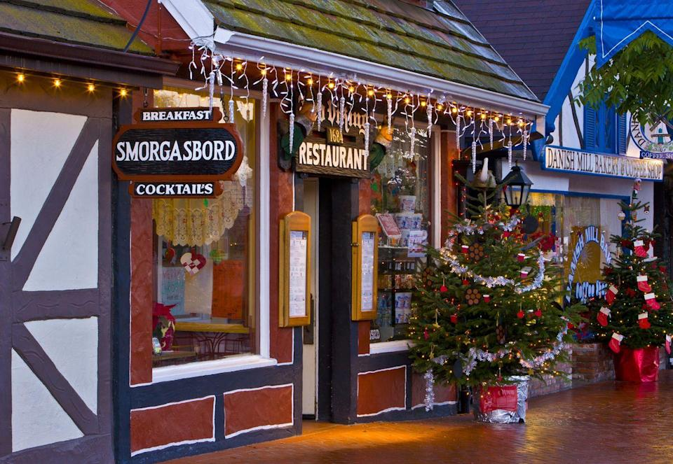 """<p>Take a trip to gorgeous <a href=""""https://go.redirectingat.com?id=74968X1596630&url=https%3A%2F%2Fwww.tripadvisor.com%2FTourism-g33103-Solvang_California-Vacations.html&sref=https%3A%2F%2Fwww.countryliving.com%2Flife%2Ftravel%2Fg2829%2Fbest-christmas-towns-in-usa%2F"""" rel=""""nofollow noopener"""" target=""""_blank"""" data-ylk=""""slk:wine country"""" class=""""link rapid-noclick-resp"""">wine country</a> this holiday season and visit <a href=""""https://go.redirectingat.com?id=74968X1596630&url=https%3A%2F%2Fwww.tripadvisor.com%2FTourism-g33103-Solvang_California-Vacations.html&sref=https%3A%2F%2Fwww.countryliving.com%2Flife%2Ftravel%2Fg2829%2Fbest-christmas-towns-in-usa%2F"""" rel=""""nofollow noopener"""" target=""""_blank"""" data-ylk=""""slk:Solvang"""" class=""""link rapid-noclick-resp"""">Solvang</a>, located in the<a href=""""https://go.redirectingat.com?id=74968X1596630&url=https%3A%2F%2Fwww.tripadvisor.com%2FTourism-g2553452-Santa_Ynez_Valley_California-Vacations.html&sref=https%3A%2F%2Fwww.countryliving.com%2Flife%2Ftravel%2Fg2829%2Fbest-christmas-towns-in-usa%2F"""" rel=""""nofollow noopener"""" target=""""_blank"""" data-ylk=""""slk:Santa Ynez Valley"""" class=""""link rapid-noclick-resp""""> Santa Ynez Valley</a>. The town hosts <a href=""""https://www.solvangjulefest.org/"""" rel=""""nofollow noopener"""" target=""""_blank"""" data-ylk=""""slk:Julefest"""" class=""""link rapid-noclick-resp"""">Julefest</a>, which lasts all December long. Guests can go on go on a Holiday Lights Tour, take part in the Santa Sprint, listen to live holiday music, and much more.</p><p><strong><a class=""""link rapid-noclick-resp"""" href=""""https://go.redirectingat.com?id=74968X1596630&url=https%3A%2F%2Fwww.tripadvisor.com%2FTourism-g33103-Solvang_California-Vacations.html&sref=https%3A%2F%2Fwww.countryliving.com%2Flife%2Ftravel%2Fg2829%2Fbest-christmas-towns-in-usa%2F"""" rel=""""nofollow noopener"""" target=""""_blank"""" data-ylk=""""slk:PLAN YOUR TRIP"""">PLAN YOUR TRIP</a></strong></p>"""