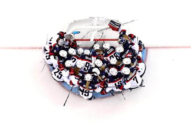 SOCHI, RUSSIA - FEBRUARY 12: The United States team huddles around the net prior to the Women's Ice Hockey Preliminary Round Group A game against the Canada on day five of the Sochi 2014 Winter Olympics at Shayba Arena on February 12, 2014 in Sochi, Russia. (Photo by Martin Rose/Getty Images)
