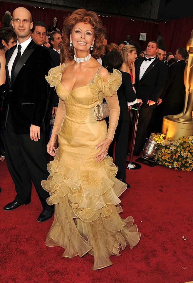 """Sophia Loren    Grade: F       The legendary star earned an immediate """"F"""" thanks to this ruffled mustard-colored mess of a dress."""