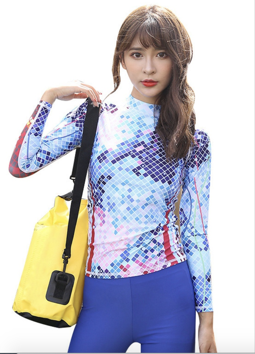 One-piece long sleeve rash guard top, S$56 (was S$60). PHOTO: Zalora