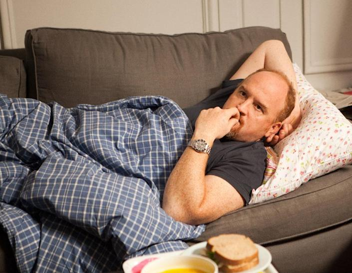 """This image released by FX shows Louis C.K. in a scene from """"Louie."""" Louis C.K. was nominated for an Emmy Award for best actor in a comedy series on, Thursday July 18, 2013. The Academy of Television Arts & Sciences' Emmy ceremony will be hosted by Neil Patrick Harris. It will air Sept. 22 on CBS. (AP Photo/FX)"""