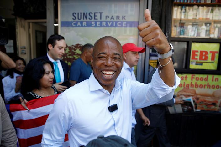 Eric Adams, Democratic candidate for New York City Mayor, greets a supporter while campaigning the Sunset Park neighborhood of Brooklyn, New York, U.S., June 15, 2021.  (Brendan McDermid/Reuters)