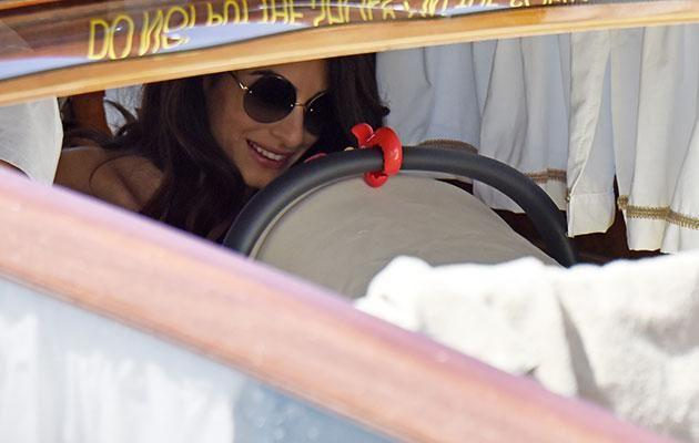 Amal could be seen sitting near her children in the boat. Source: SPLASH