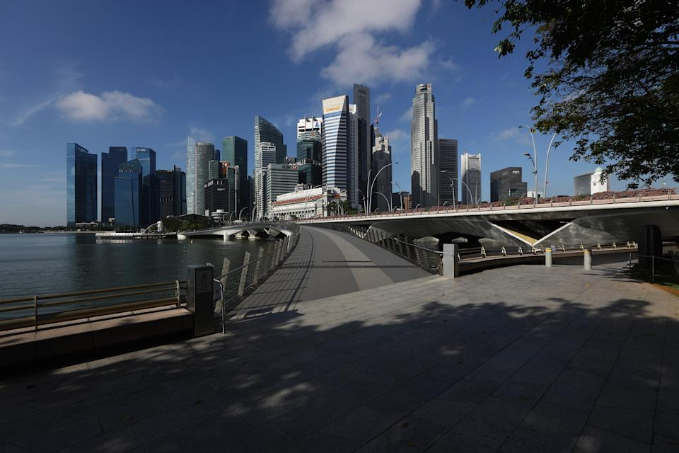 SINGAPORE - MARCH 24:  A general view of an empty attraction at a normally busy Jubilee Bridge and the Singapore skyline on March 24, 2020 in Singapore. Singapore will not allow short term visitors to enter or transit through the country from March 24 to contain the spread of the imported COVID-19  infection.  (Photo by Suhaimi Abdullah/Getty Images)