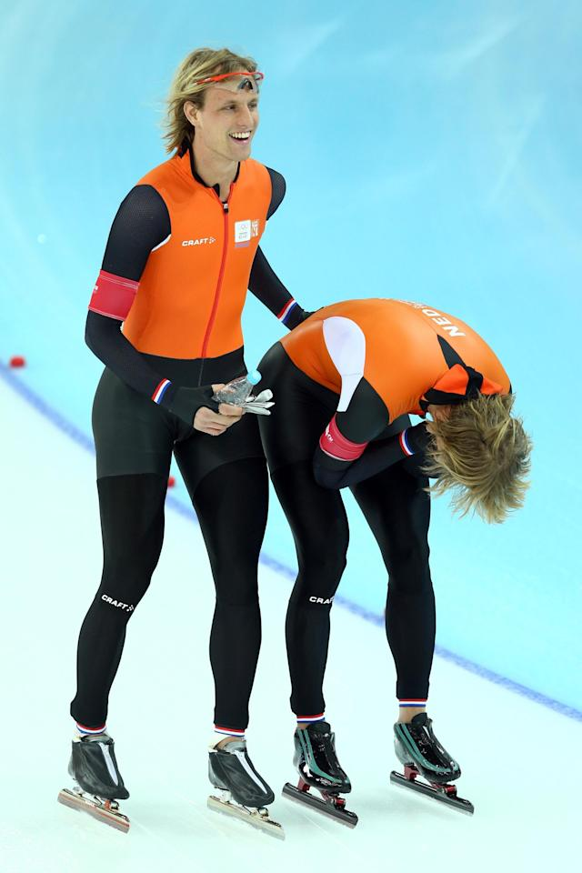 SOCHI, RUSSIA - FEBRUARY 10: Bronze medalist Roman Mulder (L) and gold medalist Michel Mulder (R) of the Netherlands celebrates during the Men's 500 m Race 2 of 2 Speed Skating event during day 3 of the Sochi 2014 Winter Olympics at Adler Arena Skating Center on February 10, 2014 in Sochi, Russia. (Photo by Paul Gilham/Getty Images)