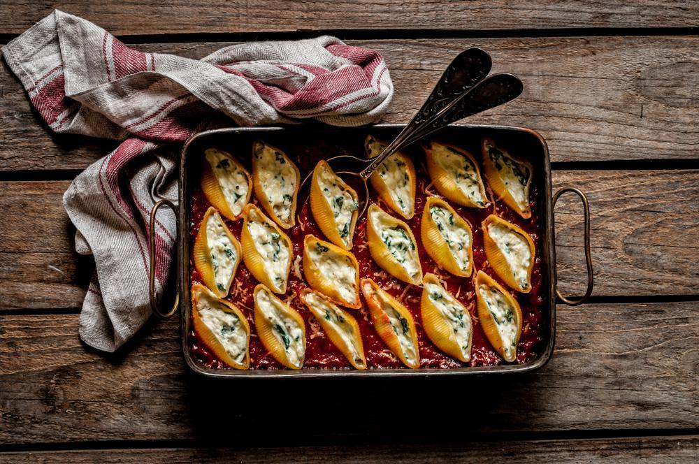 """<p>Like lasagna, stuffed shells have a similar cheese-sauce-pasta profile and hold up really well in the freezer. To take this dish to new levels, use three or four kinds of cheeses in addition to ricotta for a luscious filling, like in this <a href=""""https://www.thedailymeal.com/stuffed-shells-recipe?referrer=yahoo&category=beauty_food&include_utm=1&utm_medium=referral&utm_source=yahoo&utm_campaign=feed"""">classic stuffed shells recipe</a>.</p>"""