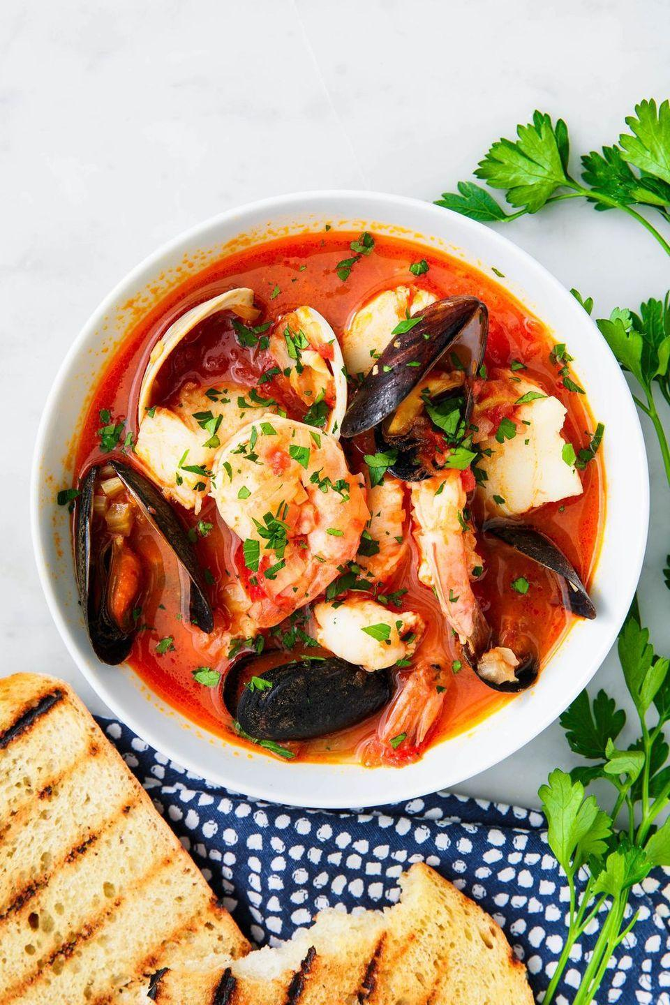 """<p>This seafood soup originated in San Francisco and it tastes like the freshest flavors of the Bay. Fill it with all your favorite seafoods to customize it to your taste. </p><p><strong><em>Get the recipe at <a href=""""https://www.delish.com/cooking/recipe-ideas/a31098212/cioppino-recipe/"""" rel=""""nofollow noopener"""" target=""""_blank"""" data-ylk=""""slk:Delish"""" class=""""link rapid-noclick-resp"""">Delish</a>. </em></strong></p>"""
