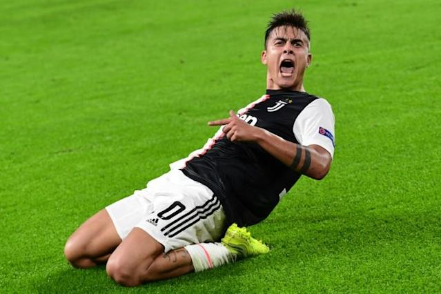 Argentine forward Paulo Dybala celebrated his second goal in two minutes for Juventus (AFP Photo/Miguel MEDINA)