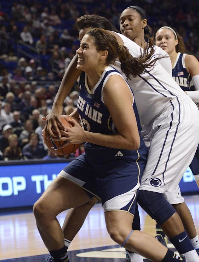Notre Dame forward Taya Reimer, left, battles for the ball with Penn State forward Talia East (5) in the first half of an NCAA college basketball game on Wednesday, Dec. 4, 2013, in State College, Pa. (AP Photo/John Beale)