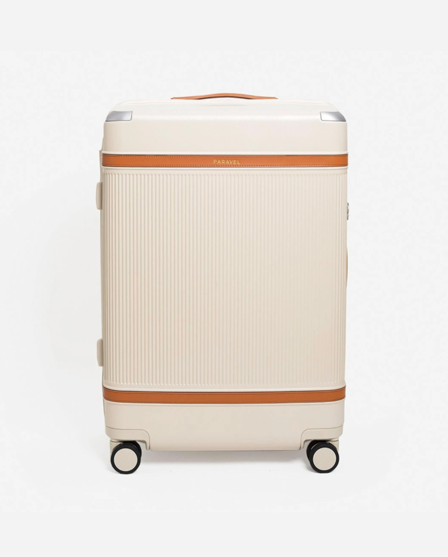 """<h2>Best Sustainable Rolling Luggage<br></h2><br><h3>Paravel Aviator Grand <br></h3><br>Yes, thanks to Paravel, even luggage can be sustainable. The Aviator Grand is crafted from upcycled plastic water bottles and has 360°-rotating wheels with carbon steel bearings for impeccably smooth rides. Also, we're obsessed with its sleek design.<br><br><strong>The Hype: </strong>4.8 out of 5 stars and 28 reviews<br><br><strong>Out Of Towners say</strong>: """"I've used large checked luggage my whole life and this is the lightest suitcase I've ever had! It doesn't slouch when I turn it on its side. It rolls like a charm. It's durable and good-looking. I am beyond pleased and I definitely plan on purchasing the carry-on.""""<br><br><em>Shop</em> <strong><em><a href=""""http://tourparavel.com"""" rel=""""nofollow noopener"""" target=""""_blank"""" data-ylk=""""slk:Paravel"""" class=""""link rapid-noclick-resp"""">Paravel</a></em></strong> <br><br><strong>Paravel</strong> Aviator Grand, $, available at <a href=""""https://go.skimresources.com/?id=30283X879131&url=https%3A%2F%2Ftourparavel.com%2Fproducts%2Fthe-aviator-grand-checked"""" rel=""""nofollow noopener"""" target=""""_blank"""" data-ylk=""""slk:Paravel"""" class=""""link rapid-noclick-resp"""">Paravel</a>"""