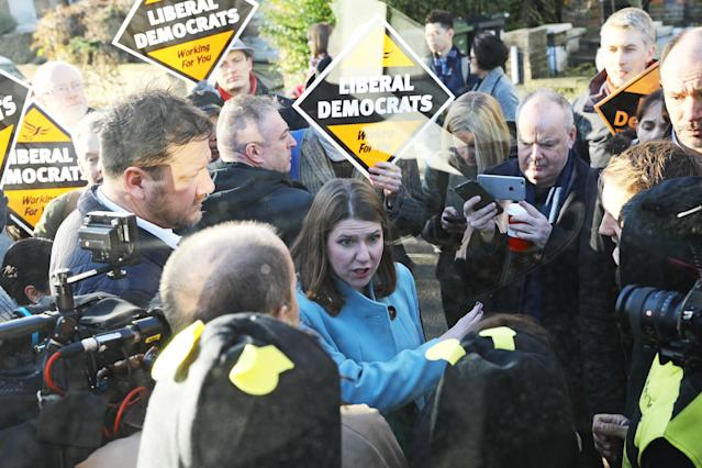 Liberal Democrat Leader Jo Swinson speaks to Extinction Rebellion protesters dressed as bees. (PA Images)