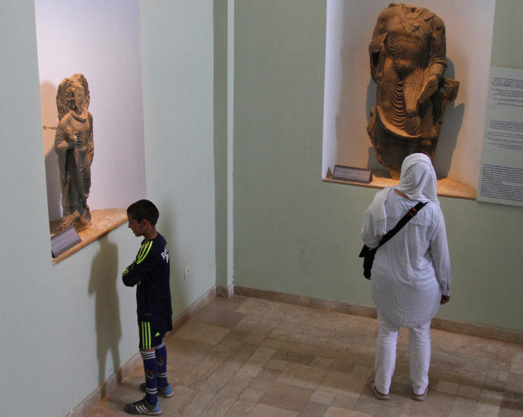 Afghans visit the National Museum in Kabul, Afghanistan, Friday, June, 28, 2013. Looters stole tens of thousands of artifacts from the National Museum of Afghanistan during the country's civil war in the 1990s, and then thousands more were destroyed by the Taliban when they took power. Now the museum is slowly coming back to life, helped by millions of dollars in U.S. and other foreign aid. Every day 300 to 400 visitors a day come to see the collections of sculptures, jewelry, coins and other artifacts dating from the Stone Age through the 20th century.(AP Photo/Ahmad Jamshid)