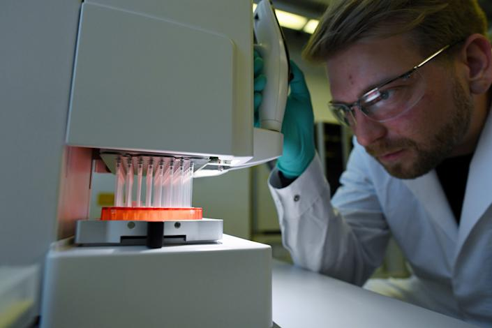 Employee Philipp Hoffmann, of German biopharmaceutical company CureVac, demonstrates research workflow on a vaccine for the coronavirus (COVID-19) disease at a laboratory in Tuebingen, Germany on March 12, 2020. (Andreas Gebert/Reuters)
