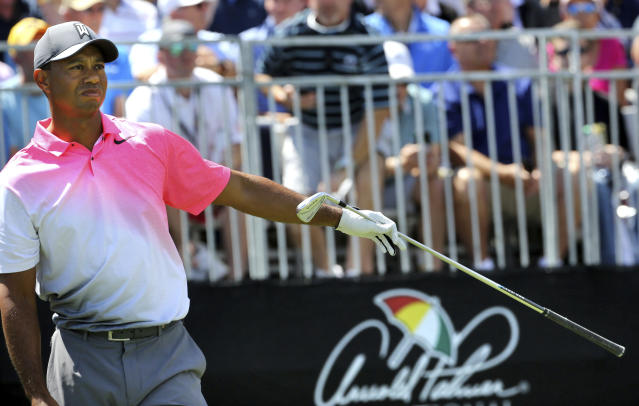 Tiger Woods points to his left after driving wide on his first tee-off to start his the second round of the Arnold Palmer Invitational golf tournament Friday, March 16, 2018, in Orlando, Fla. (Joe Burbank/Orlando Sentinel via AP)
